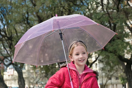 Little girl with umbrella in park photo
