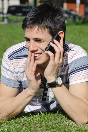 celphone: Handsome man outdoors talking on the phone