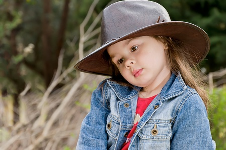 adorable little girl in cowboy hat photo