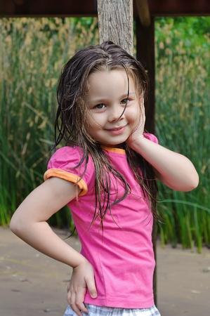 Beautiful little portrait of girl in park photo