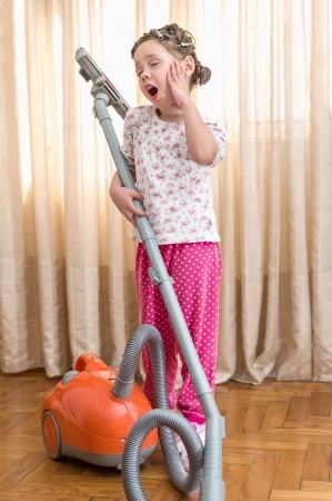 little girl with vacuum cleaner photo