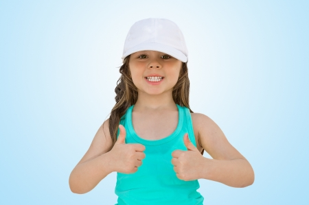 Portrait of a beautiful and confident girl showing thumbs up photo