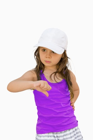 Little girl  hand is showing thumb down..