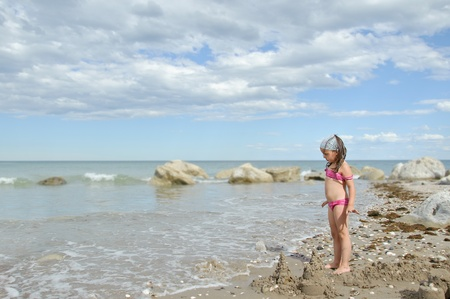 children sandcastle: girl at  beach playing