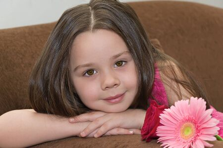 Beautiful little girl with a flower. photo