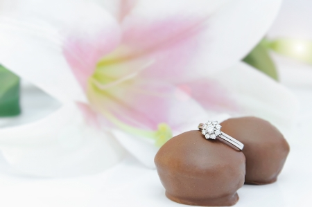 Chocolate treats with engagement ring photo