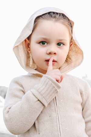 hushed: beautiful little girl say silence is a secret