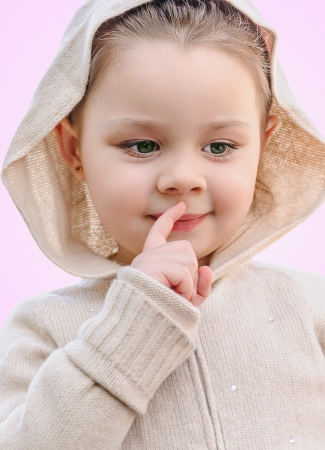 adorable little girl say silence is a secret photo