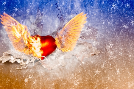 Red stone heart with wings burning himself photo