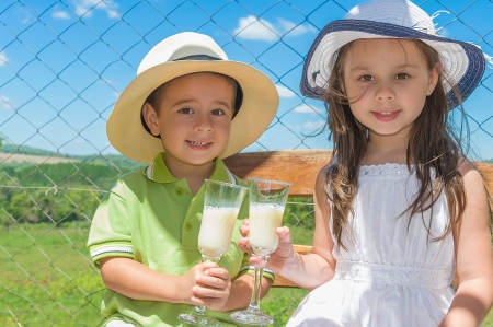provide children outdoors with soy milk photo