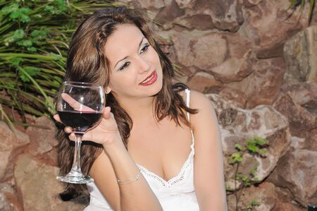 Beautiful woman with a glass of red wine photo