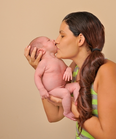happy young mother with newborn baby photo