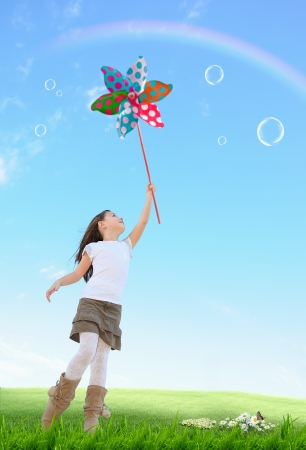 Cute girl with colored windmill toy Stock Photo