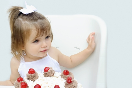 portrait of little girl with cake photo