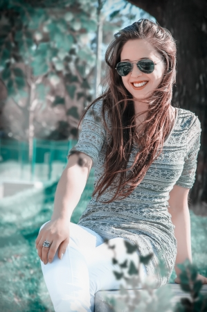 beautiful woman in park enjoying outdoor photo