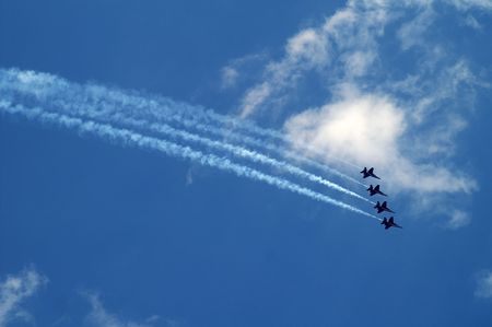 f18: Four Blue Angels F-18 fighter jets flying in formation Stock Photo