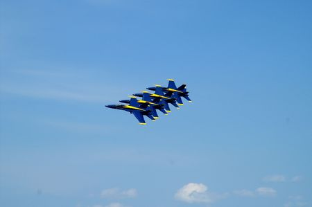 Four US Navy Blue Angels jets flying in tight stack formation Stock Photo