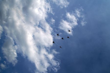 Six US navy fighter jets breaking away out of the cloud Stock Photo