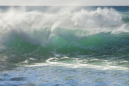 breaking: Breaking green wave in the seaside Stock Photo