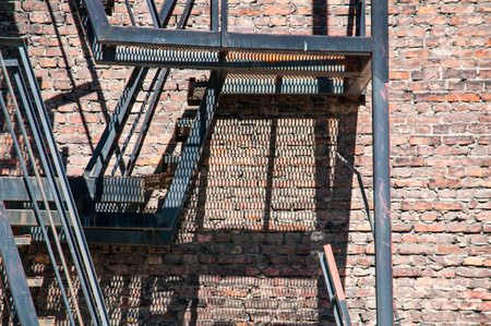 fire brick: Old external fire escape staircase in the brick factory building