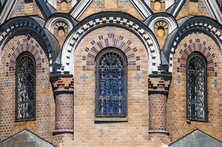 eclecticism: Arched windows of the Church of the Savior on Spilled Blood in Saint Petersburg city in Russia. Common pattern of Russian Architecture