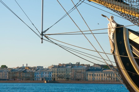 bowsprit: Caryatid in the bowsprit of a big sailing ship on a river in Saint Petersburg city in Russia Stock Photo