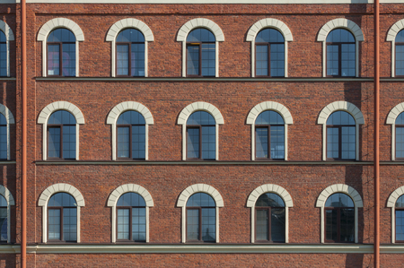 frontage: Many equal windows of the factory in Saint Petersburg city in Russia Stock Photo