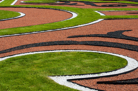 uncommon: Uncommon modern abstract outdoor composition of curves with grass and gravel