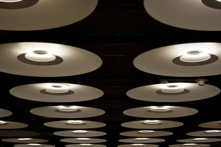 barajas: Modern ceiling structure with many circular lamps in Barajas international airport in Madrid