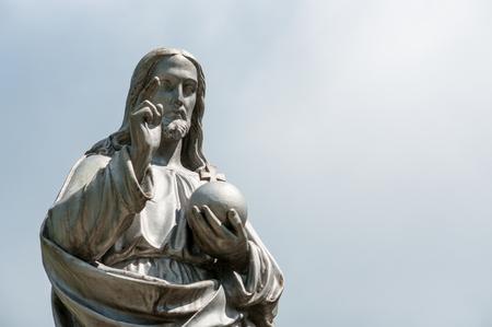 jesus standing: Jesus Christ statue on blue Stock Photo