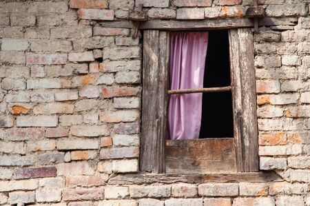 dejection: Small window of an ancient building in Kathmandu valley, Nepal