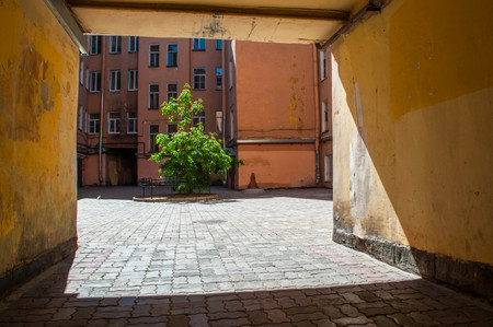 cramped: Common cramped courtyard inside of several residential houses of Saint Petersburg in Russia