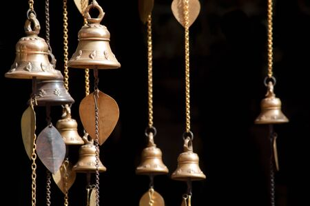 campanas: Little praying bells hanging on old temple in Nepal
