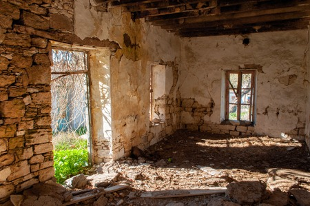without windows: Ruins of the Turkish abandoned village in Cyprus. Interior of ruined house without door and windows Stock Photo