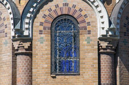 eclecticism: Arched window of the Church of the Savior on Spilled Blood in Saint Petersburg city in Russia. Common pattern of Russian Architecture Stock Photo