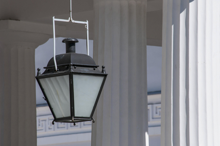 classical greek: Simple lantern in classical Greek temple with columns on the background