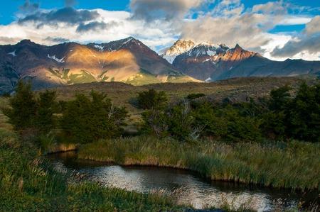 streamlet: Sunrise in Patagonian Andes. Small river near Viedma lake, Los Glaciares national park