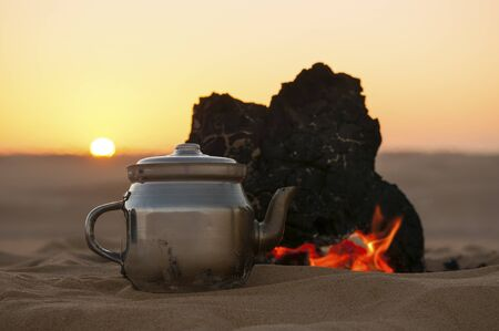 Tea making in Sahara desert in Egypt, sunset