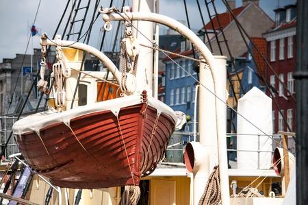 Life boat on the devit in marina, Kopenhagen, Denmark Stock Photo