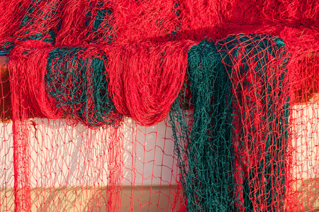 Bright fishing net with floats closeup