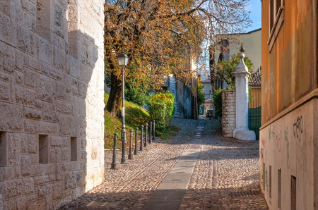 View of narrow street in Brescia in Lombardy. Italy Stock Photo