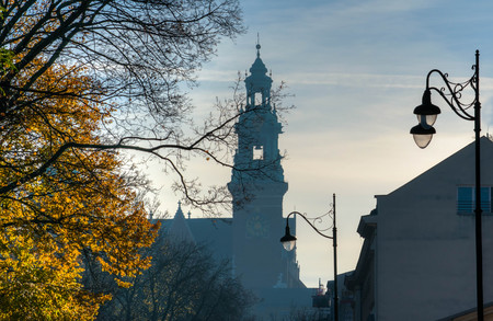 Krakow medieval town foggy silhouette in october, early morning Stock Photo