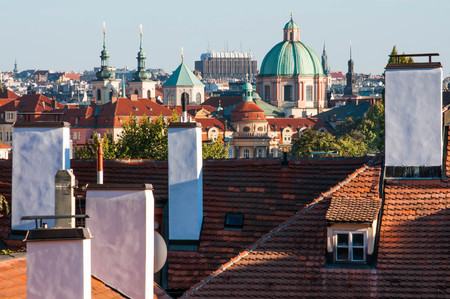 Old red roofs and chimneys of Prague. View from above