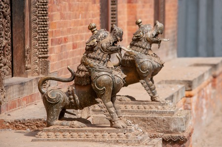 A lion guard in front of a temple in the historical center of Kathmandu, Nepal