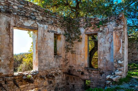 Interior of abandoned ruined house in Cyprus. Broken inner wall Фото со стока