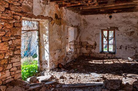 Interior of abandoned ruined house in Cyprus. Broken inner wall Stock fotó