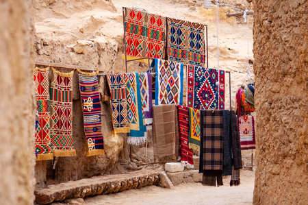Traditional handmade oriental carpets in souvenir shop in Siwa oasis