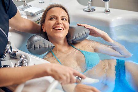 Woman receiving the subaqual massage in a beauty salon Archivio Fotografico