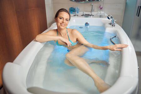 Pretty woman sitting in a spa bath