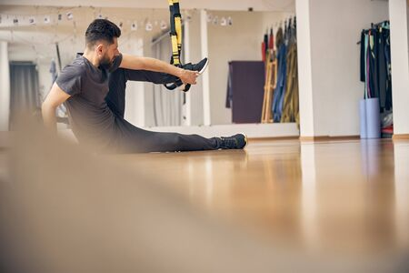Male athlete getting ready for training indoors